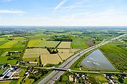 Nederland, Gelderland, Gemeente Geldermalsen, 13-05-2019; Diefdijk, doorsneden door rijksweg A2. Nieuwe ontworpen kering met brug en kazemat (UN studio), de coupure kan bij extreem hoog water afgesloten worden door betonnen balken. De Diefdijk is een binnendijk en oorspronkelijk aangelegd om de Alblasserwaard en de Vijfherenlanden tegen wateroverlast uit de Betuwe te beschermen. Daarnaast maakt de dijk onderdeel uit van Hollandse Waterlinie.<br /> Diefdijk, intersected by A2. The cut can be closed with concrete beams in case of extremely high water. The inner dike was originally built to protect the polders Alblasserwaard and Vijfherenlanden against flooding from the Betuwe.<br /> luchtfoto (toeslag op standard tarieven);<br /> aerial photo (additional fee required);<br /> copyright foto/photo Siebe Swart