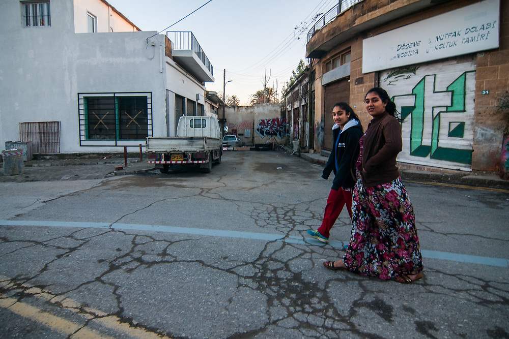 Two girls walk next to the wall that divide the city of Nicosia, Cyprus.<br /> Nicosia was divided into the southern Greek Cypriot and the northern Turkish Cypriot parts in 1963, following the intercommunal violence that broke out in the city. Today, the northern part of the city is the capital of Northern Cyprus, a de facto state that is considered to be occupied Cypriot territory by the international community. ©Simone Padovani / Awakening