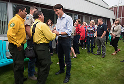 Prime Minister Justin Trudeau, centre, speaks with Alfredo Nolasco, second left, Fire Handling Manager of Mexicỏۢs National Forest Commission (CONAFOR), as Miguel Campos, left, a representative of CONAFOR listens, during a visit to the Prince George Fire Centre, in Prince George, B.C., on Thursday August 23, 2018. Photo by Darryl Dyck/CP/ABACAPRESS.COM