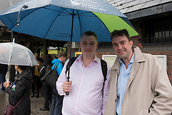 © Licensed to London News Pictures. 16/09/2016. Watford, UK.  (L to R) Jonny Carruthers and Peters Jenkins from Berkhamstead are amongst the passengers waiting to be collected outside Kings Langley rail station following the derailment by a landslide of a train bound for London Euston. They were transferred from the derailed train to a rescue train and exited at Kings Langley.  Apart from one person who suffered whiplash, there were no other reported injuries. Photo credit : Stephen Chung/LNP