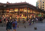 Mercado de San Miguel market historic building exterior lights in evening, Madrid city centre, Spain built 1916