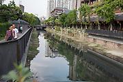 A canal and arched bridge, Chengdu, Kuan Zhai Xiang Zi historic city. Sichuan, China