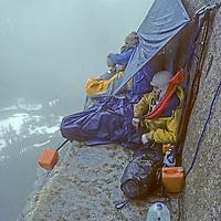 ROCK CLIMBING, Yosemite, El Capitan. Jay Jensen & Doug Robinson (MR) in rainy bivouac at El Cap Tower, halfway up Nose route during February, 1978.