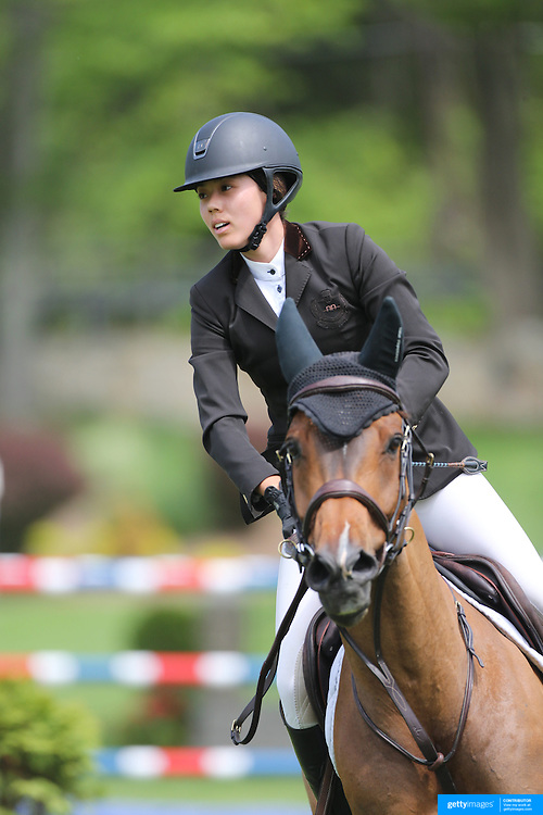 Karen Polle riding With Wings in action during the $35,000 Grand Prix of North Salem presented by Karina Brez Jewelry during the Old Salem Farm Spring Horse Show, North Salem, New York, USA. 15th May 2015. Photo Tim Clayton