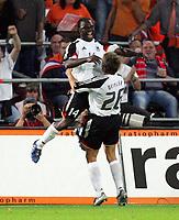Fotball<br /> 17.08.2005<br /> Nederland v Tyskland 2-2<br /> Foto: Witters/Digitalsport<br /> NORWAY ONLY<br /> <br /> Jubel 2:2 Gerald Asamoah , Sebastian Deisler