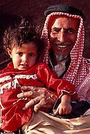 Sheikh Fraywan Shaalan of the Ruwallah with his granddaughter near Zalum, Saudi Arabia
