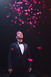 """© Licensed to London News Pictures. 04/08/2015. London, UK. Scott Garnham as Baron Felix von Gaigern. """"Grand Hotel"""" opens for a six week run at the Southwark Playhouse from 31 July to 5 September 2015. The 17-strong international cast is led by Italian musical theatre star Christine Grimandi. The show, based on Vicki Baum's Grand Hotel is written by Luther Davis and directed by Thom Southerland, music and lyrics by Geroge Forrest and Robert Wright. Photo credit: Bettina Strenske/LNP"""