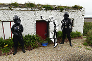 """Stormtroopers on duty at the Fáilte Ireland's first 'May the Fourth Be With You' festival in Portmagee, County Kerry at the weekend.<br /> Photo: Don MacMonagle<br /> <br /> pr photo photo<br /> Further info: lucy.cefai@failteireland.ie<br /> <br /> Press release:<br /> The Fourth Runs Strong in Kerry - Star Wars fans descend on Kerry for Fáilte Ireland's first 'May the Fourth Be With You' festival.<br /> Fáilte Ireland's first 'May the Fourth Be With You' festival wraps up today after three days of events across the Kerry villages of Ballyferriter, Portmagee, Ballinskelligs and Valentia Island. The festival kicked off on Friday, May the 4th (the day when fans across the globe commemorate the Star Wars Universe) and sought to capitalise on the enthusiasm for the galaxy far far way, firmly placing Ireland within that galaxy. The festival included a host of fun activities for all-ages, including visits to Slea Head's beehive huts (Luke Skywalker's hideaway of choice), guided film location walks and children's workshops.<br /> A highlight over the weekend was a special céilí for Star Wars fans which saw costumed dancers take the stage in a great meeting of traditional Irish culture and the Star Wars Universe. Fans also had the opportunity to enjoy outdoor drive-in movie screenings set against the breath-taking backdrop of the west Kerry coast, which featured in the latest movie installation.<br /> Fáilte Ireland captured the excitement in a video which will be used to build on the connection Ireland has with this iconic film universe after recent Star Wars filming took place along the Wild Atlantic Way.<br /> Speaking about the festival, Minister of State for Tourism and Sport, Brendan Griffin said:<br /> """"Since Star Wars included some of our iconic Irish landscapes along the Wild Atlantic Way in recent films, I have been keen to mark May the Fourth in a meaningful way. When appointed as Minister last summer, I approached Fáilte Ireland with this proposal. The inaugura"""