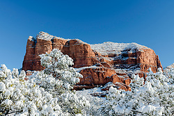 Winter magic in Sedona Arizona. The juxtaposition of the frosting of deep winter upon the ochre buttes of the desert southwest, crowned with the typical, iconic deep blue sky is the most pleasant assault on commonalitypleasent assualt on commonality.