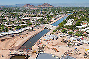 26 AUGUST 2005 - Construction at the Scottsdale Riverfront redevelopment project. This is looking to south-southwest along the CAP canal towards Camleback Mountain. Jay Kelso is operating the crane, which is about 300 feet above the base of the excavation. PHOTO BY JACK KURTZ