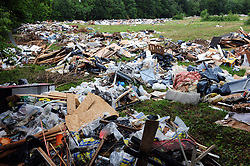 © Licensed to London News Pictures. 22/07/2017<br /> TRAVELLERS LEAVE AN ESTIMATED 250 TONES OF RUBBISH AFTER BEING EVICTED .<br /> After 14 days of no help from Bromley Council A group called Thornet Wood Co Owners had to take out a private injuction to have travellers removed from private land Called Blackbrook Lane Land which is adjacent to Thornet Wood Road, Bickley, Greater London.  The travellers have left 250 tons of rubbish behind including baths,bricks,mattresses,wood,fridges,plastics etc..while the fire brigade and Enviroment agency are happy there is no hazardous waste it is now going to cost the consortium of land owners an estimated £100,000 to clear and clean the site.<br /> Photo credit: Grant Falvey/LNP