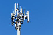3 sector cellular telecom communications panel antenna array for the mobile telephone system on a cellsite pole tower. <br />