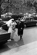An unusual sight at UCD ( Earlsfort Terrace) as groom John Quirke, Straffan, Co Kildare, arrives with his bride of 45 minutes, Mary Claire Harney, Stapleton Place, Dundalk, to receive his B.E. on Conferring Day. <br /> 14.07.1964