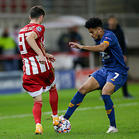 PIRAEUS, GREECE - DECEMBER 09: Luis Díaz of FC Porto and Lazar Randjelović of Olympiacos FC during the UEFA Champions League Group C stage match between Olympiacos FC and FC Porto at Karaiskakis Stadium on December 9, 2020 in Piraeus, Greece. (Photo by MB Media)