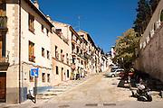 Cuesta de la Victoria street leading uphill into the Albaicin district, Granada, Spain