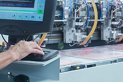 Male engineer working on computer in industry, Hanover, Lower Saxony, Germany