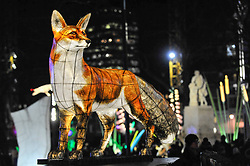 """© Licensed to London News Pictures. 18/01/2018. LONDON, UK. """"Nightlife"""" by Lantern Company with Jo Pocock transforms Leicester Square Gardens into an enchanted forest with animals and flowers.   Opening night of Lumiere London, the capital's largest arts festival commissioned by The Mayor of London and produced by Artichoke.  Light installations by leading artists have been set up, both north and south of the river for the public to view 18-21 January. Photo credit: Stephen Chung/LNP"""