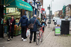 © Licensed to London News Pictures. 03/12/2015. London, UK. Labor party leader JEREMY CORBYN (centre)  leaving his London home pushing his bike the morning after the UK parliament voted to bomb in Syria. Photo credit: Ben Cawthra/LNP