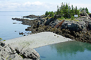 A rising tide narrows the access path to the Head Harbor Light on Campobello Island. Soon it will be under water.