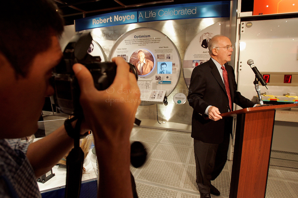 Santa Clara, CA - JUNE 15:   A member of the press takes a photo of Gordon Moore as he speaks to the crowd during an Intel Corporation dedication of an exhibit celebrating the life and accomplishments of co-founder Robert Noyce on June 16, 2005 in Santa Clara, California.  Photo by David Paul Morris