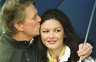 Michael Douglas and Catherine Zeta-Jones pictured at the Old Course, St. Andrews before the actor teed off in the annual Dunhill pro-celebrity golf tournament where he partnered Ernie Els.