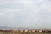 Las Vegas suburban housing in the desert. The rapid population growth of las Vegas has led to a significant urbanization of desert lands into industrial and commercial areas, especially in the  Las Vegas Valley. The Valley is a 600 sq mile basin area that contains the largest concentration of people in the state. Having part of the region located in a desert basin creates issues with air quality from smog dust & pollen.