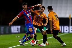 Joel Ward of Crystal Palace takes on Diogo Jota of Wolverhampton Wanderers and Jonny of Wolverhampton Wanderers - Mandatory by-line: Robbie Stephenson/JMP - 20/07/2020 - FOOTBALL - Molineux - Wolverhampton, England - Wolverhampton Wanderers v Crystal Palace - Premier League