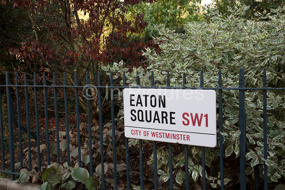 Sign for Eaton Square in Belgravia London, United Kingdom. Belgravia is a district in West London in the City of Westminster and the Royal Borough of Kensington and Chelsea. It is noted for its very expensive residential properties and is one of the wealthiest districts in the world. Much of it, known as the Grosvenor Estate, is still owned by a family property company, the Duke of Westminsters Grosvenor Group.