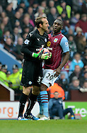 Mark Schwarzer gathers the ball ahead of Christian Benteke during the The FA Cup match between Aston Villa and Leicester City at Villa Park, Birmingham, England on 15 February 2015. Photo by Alan Franklin.