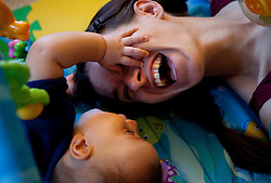 Baby Boy Touching Mother's Face