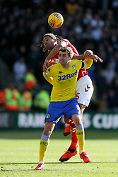 Leeds United's Patrick Bamford (bottom) and Middlesbrough's Ryan Shotton challenge during the Sky Bet Championship match at The Riverside Stadium, Middlesbrough.