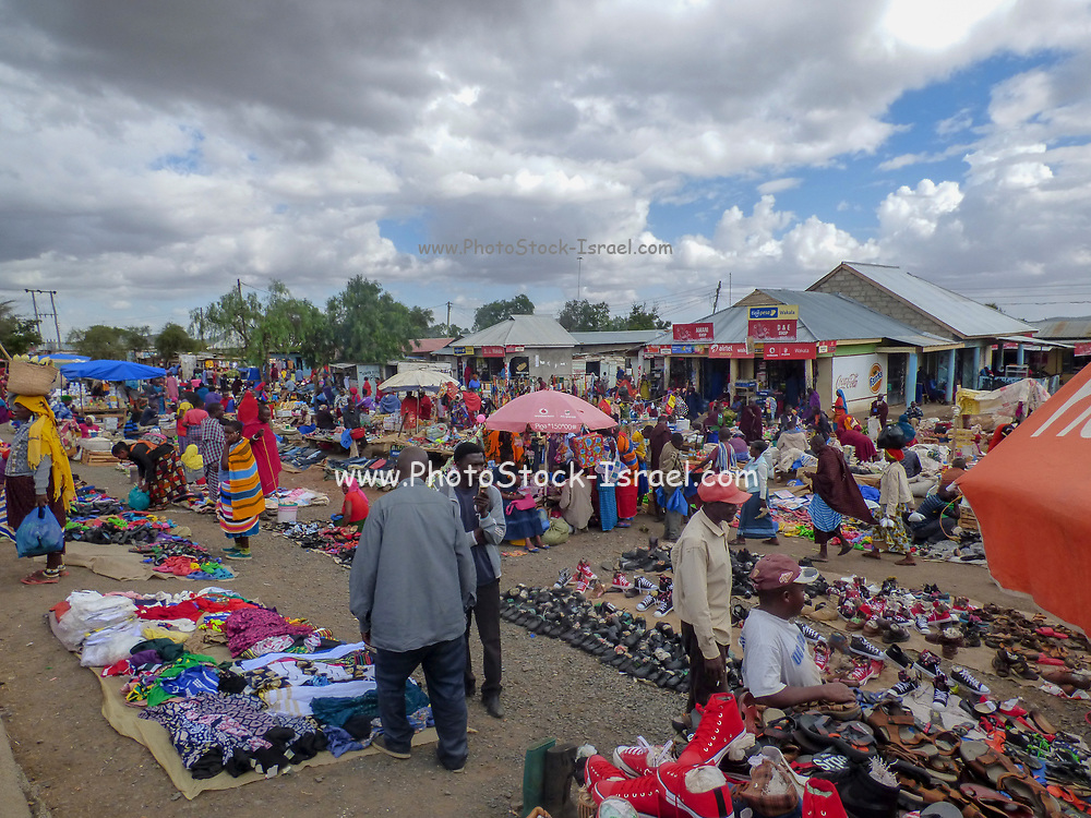 Africa, Tanzania, Frontier Market selling products to the local population. The goods are placed on a blanket on the ground