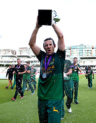Chris Read of Nottinghamshire is sprayed with champagne by Luke Fletcher of Nottinghamshire while lifting the Royal London One-Day Cup Trophy after their side's win over Surrey - Mandatory by-line: Robbie Stephenson/JMP - 01/07/2017 - CRICKET - Lord's Cricket Ground - London, United Kingdom - Nottinghamshire v Surrey - Royal London One-Day Cup Final 2017