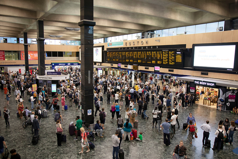 Interior view of the main concourse full of commuters and people travelling from Euston Railway Station in London, United Kingdom. Euston is a central London railway terminus and mainline station in central London, managed by Network Rail. The station is the fifth-busiest station in Britain and the countrys busiest inter-city passenger terminal, providing a gateway from London to the North.