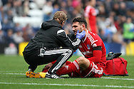 Sean Morrison of Cardiff City receives treatment after a clash of heads. Skybet football league championship match, Preston North End v Cardiff City at the Deepdale stadium in Preston, Lancashire on Saturday 17th October 2105.<br /> pic by Chris Stading, Andrew Orchard sports photography.