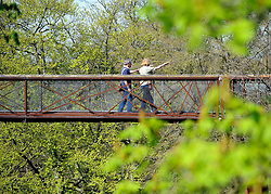 ©London News pictures. 07/04/2011. KEW: A couple explore the tree tops on the 'treetop' walkway. People enjoy the continuing unusual hot weather in Kew, West London, today (Thur). Forecasters expect the hot spell to continue into the weekend. Picture credit should read Stephen Simpson/LNP