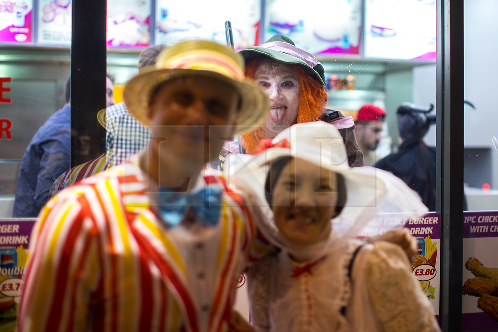 © Licensed to London News Pictures . 08/04/2017 . Manchester , UK . A Disney themed pub crawl passes through The Printworks in Manchester City Centre . Greater Manchester Police have authorised dispersal powers and say they will ban people from the city centre for 48 hours , this evening (7th April 2017) , in order to tackle alcohol and spice abuse . Photo credit : Joel Goodman/LNP
