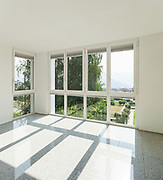 Architecture, interior of a modern house, wide room with windows