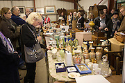 People looking at lots of antiques and household goods during an auction at Abbots sale rooms, Campsea Ashe, Suffolk, England