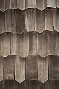 Close up, full frame picture of wooden shingle tiles, exterior of Church of Vilupulli, Chiloe Island, Chile