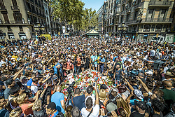 August 18, 2017 - Barcelona, Catalonia, Spain - Thousands gather around a  makeshift memorial on top of a Joan Míro mosaic in Las Ramblas, the site where a van came to a halt after a 550 meter long jihadist terror trip. Thirteen people were killed and almost 80 wounded, 15 seriously, when the van tore through the crowd (Credit Image: © Matthias Oesterle via ZUMA Wire)