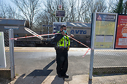 © Licensed to London News Pictures 23/04/2021. Dunton Green, UK. Police on scene. A freight train has caught fire this morning on the tracks outside Dunton Green Train Station in Kent, firefighters extinguished the blaze and engineers are now working to remove it. Photo credit:Grant Falvey/LNP