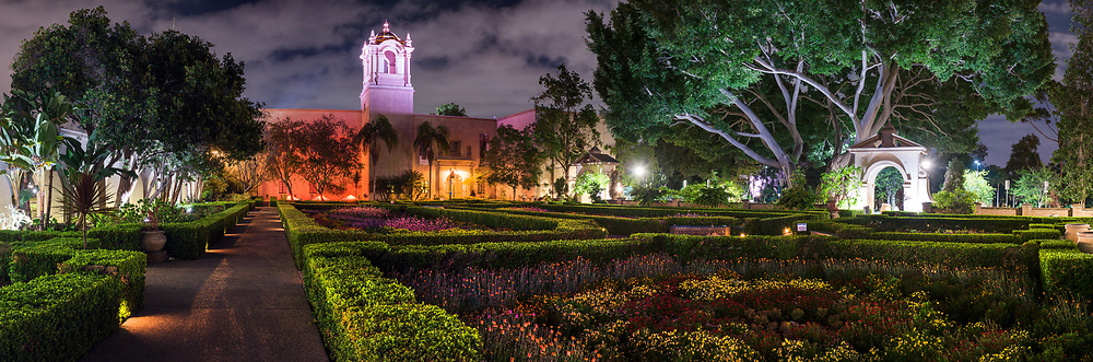 The Alcazar Garden in Balboa Park is lit under the night sky of San Diego, CA. The garden is named after the gardens of Alcazar Castle in Seville, Spain, and is reconstructed to be identical to the1935 design by San Diego architect Richard Requa for the California Pacific International Exposition of 1935-1936.