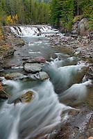 Rushing waters of McDonald Creek Glacier National Park Montana USA