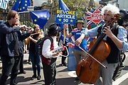 Pro remain musicians play instruments  outside the Houses of Parliament in central London, England, United Kingdom on 21st May 2019. Britain will take part in the European Parliament election being held in two days time. Britain will take part in the European Parliament election being held in two days time.