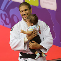 Gold medalist Krisztian Toth of Hungary celebrates his victory with his child during an awards ceremony after the Men -90 kg category at the Judo Grand Prix Budapest 2018 international judo tournament held in Budapest, Hungary on Aug. 12, 2018. ATTILA VOLGYI