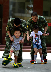 May 31, 2017 - Shenzhen, Shenzhen, China - Shenzhen, CHINA-May 31  2017: (EDITORIAL USE ONLY. CHINA OUT)..Soldiers' kids have a good time with their parents in south China's Shenzhen, May 31st, 2017, marking Children's Day. (Credit Image: © SIPA Asia via ZUMA Wire)