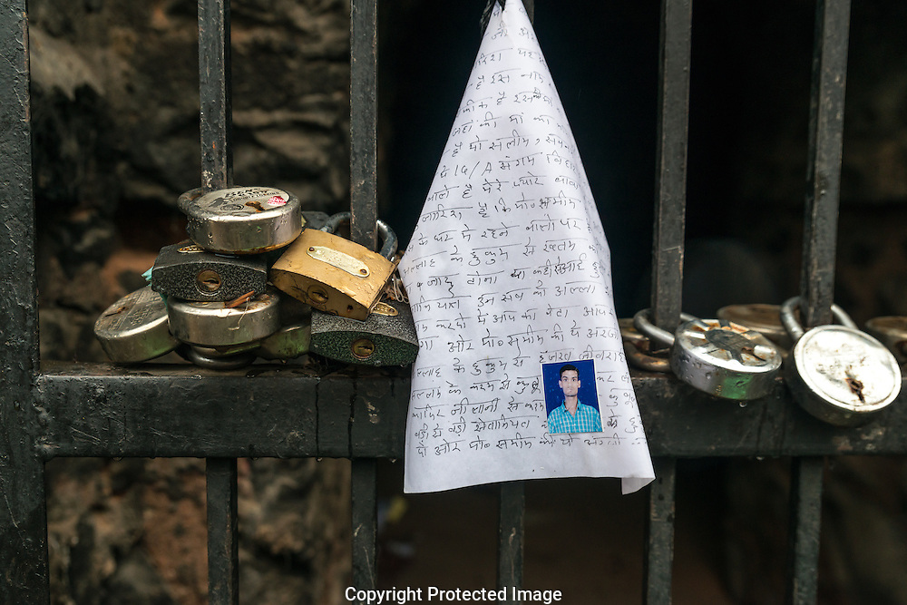 A letter and locks to the gate of one of the Grottos. The locks signify a bond an agreement.