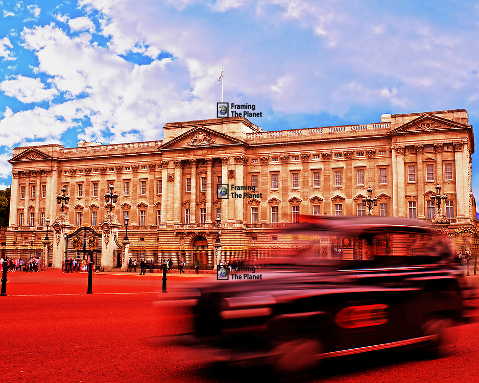 There can be few images that sum up Britain and its history than this, a black cab rushing passed the front of Buckingham Palace, the main royal palace in the city of London. In this photo we have the full front façade against a rich blue sky with a blurred black cab rushing past in the foreground. This sums up the outside and tourist view of the city. <br /> <br /> The British capitol has long been home to and ruled by the Royal Family, now the house of Windsor they are the head of state of both the UK and most Commonwealth nations. Today they have no political power, they act as ambassadors for the UK and the other countries they are head of state for such as Australia, New Zealand and Canada.