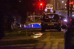 A large police cordon surrounds the scene where a woman was stabbed to death on a bus near London Road in North Cheam, Surrey. North Cheam, Surrey, February 08 2019.